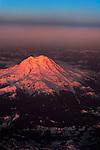 Sunset glow on Mount Rainier from sky.