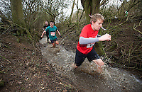 06 FEB 2011 - SIBBERTOFT, GBR - Eventual race winner Keith Wardell races through the brook during the Avalanche Adventure Run (PHOTO (C) NIGEL FARROW)