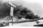 A shopping mall is burned and looted in the mid-city area of Los Angeles.
