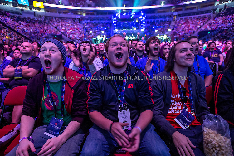 7/18/2014&mdash;Seattle, WA, USA<br /> <br /> &quot;The International&quot; is a video-game tournament hosted by Valve, a game maker based in Bellevue, WASH., with a prize pool reaching $10.8 million. this year the event was held at Key Arena in Seattle, WASH.<br /> <br /> HERE: Bill Jarvis, 24 (center) and Michal Broniek, 22 (left) react to a match between the teams during the DOTA 2 semi-finals.<br /> <br /> Contestants were playing Dota 2, a 2013 multiplayer online battle arena video game developed by Valve. Five players are on each team, with teams traveling for around the world to battle at the sold-out event.<br /> <br /> <br /> Photograph by Stuart Isett<br /> &copy;2014 Stuart Isett. All rights reserved.