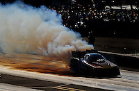 Sept. 18, 2010; Concord, NC, USA; NHRA funny car driver Bob Bode does a burnout during qualifying for the O'Reilly Auto Parts NHRA Nationals at zMax Dragway. Mandatory Credit: Mark J. Rebilas /