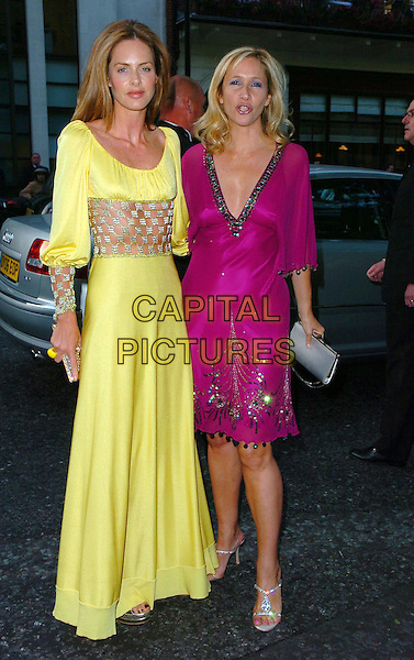 TRINNY WOODALL & TANIA BRYER.Arrivals - The Glamour Magazine 3rd Annual Women Of The Year Awards, Berkeley Square, London, England, .June 6th 2006..full length pink dress yellow cut away out midriff crystals jewelled diamante sleeves skin see through.Ref: CAN.www.capitalpictures.com.sales@capitalpictures.com.©Can Nguyen/Capital Pictures