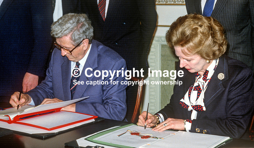 Signing of Anglo-Irish Agreement by Margaret Thatcher, Prime Minister, UK, and Garret Fitzgerald, Prime Minister, An Taoiseach, Rep of Ireland, at Hillsborough Castle, N Ireland, 15th November 1985.1985111505h.<br />