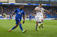Loic Damour of Cardiff City crosses past Craig Forsyth of Derby County during the Sky Bet Championship match between Cardiff City and Derby County at Cardiff City Stadium, Cardiff, Wales on 30 September 2017. Photo by Mark  Hawkins / PRiME Media Images.