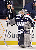 Mat Myers (UNH), Matt Di Girolamo (UNH - 30) - The University of Maine Black Bears defeated the University of New Hampshire Wildcats 5-4 in overtime on Saturday, January 7, 2012, at Fenway Park in Boston, Massachusetts.