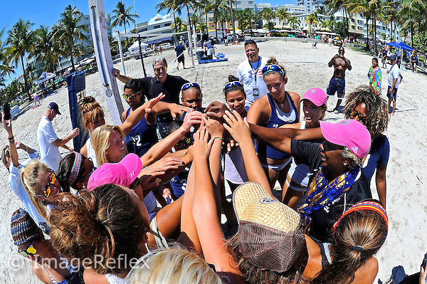 6 April 2013:  FIU Sand Volleyball Head Coach Rita Buck-Crockett gathers with her team after the match as the FIU Golden Panthers defeated the Florida Gulf Coast University Eagles, 5-0, to win the Doctor's Hospital FIU South Beach Invitational match at Lummus Park Beach on Miami Beach, Florida.