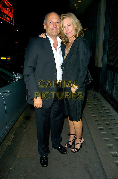 RON DENNIS & GUEST.(F1 Maclaren Team Boss).Spotted outside The Ivy Restaurant,.London, England, August 20th 2007..full length black suit white shirt Formula One .CAP/CAN.©Can Nguyen/Capital Pictures