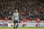Nottingham Forest players celebrating midfielder Lewis McGugan's goal at the City Ground, Nottingham as Forest take on visitors Ipswich Town in an Npower Championship match. Forest won the match by two goals to nil in front of 22,935 spectators, with McGugan scoring the second goal.