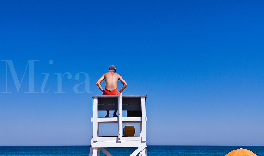 Lifeguard watches over ocean waters, Cape Cod National Seashore, Cape Cod, MA, Massachusetts, USA