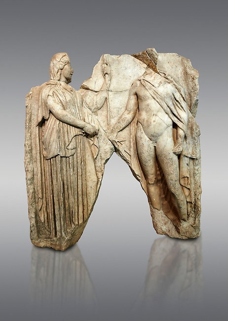 Roman Sebasteion relief  sculpture of Demeter and Triptolemos, Aphrodisias Museum, Aphrodisias, Turkey. <br /> <br /> Deneter - stately, veiled and holding a sceptre - hands a bunch of wheat stalks to the young hero Trptolomos. Demeter was the grain goddess, and it was Triptolemos, a hero from Eleusis near Athens, whom she chose to bring grain cultivation to mankind