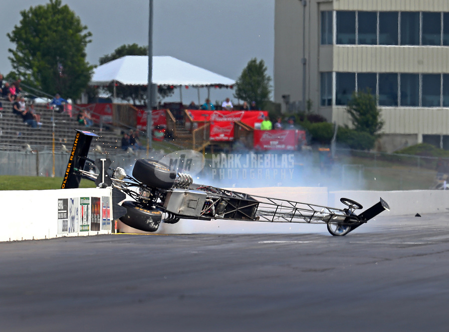 May 21, 2018; Topeka, KS, USA; NHRA top alcohol dragster driver Steve Collier suffers a blowover crash during the Heartland Nationals at Heartland Motorsports Park. Collier was talking with safety personnel before being transported to a local hospital for an evaluation. Mandatory Credit: Mark J. Rebilas-USA TODAY Sports