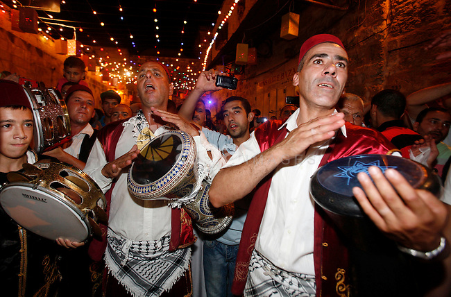 Palestinian musicians perform in Jerusalem's Old City during celebrations to mark the breaking of the fast on the seventh day of the holy month of Ramadan, on July 26, 2012. Photo by Mahfouz Abu Turk