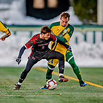 13 November 2019: University of Hartford Hawk Midfielder Sergi Martinez, a Sophomore from Barcelona, Spain, keeps the ball away from University of Vermont Catamount Midfielder Joe Morrison, a Sophomore from Foxboro, MA, at Virtue Field in Burlington, Vermont. The Hawks defeated the Catamounts 3-2 in sudden death overtime of the Division 1 Men's Soccer America East matchup. Mandatory Credit: Ed Wolfstein Photo *** RAW (NEF) Image File Available ***