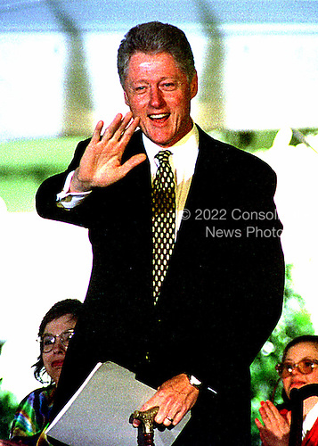 United States President Bill Clinton waves to invited guests as he prepares to sign the Individuals with Disabilities Education Act (IDEA) Re-authorization Act at a ceremony at the White House in Washington, D.C. on June 4, 1997..Credit: Ron Sachs / CNP