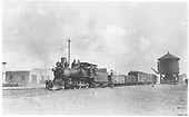 T-12 #174 with consist of unusual water car, gondola and three revenue cars.<br /> D&amp;RG  Antonito, CO  Taken by Grandt, Robert L. - ca. 1920