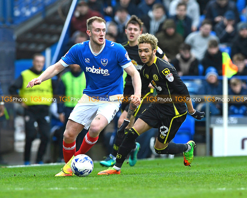 Matthew Clarke of Portsmouth holds the ball up from Alex Kiwomya of Crewe Alexandra during Portsmouth vs Crewe Alexandra, Sky Bet EFL League 2 Football at Fratton Park on 4th March 2017