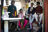 SOWETO, SOUTH AFRICA JULY 4: Floyd Avenue, Sibu Sithole, Lethabo Tsatsinyane  and Teekay Makwale, young designers part of the group Smarteez chat in their workshop on July 4, 2014 in Jabulani section of Soweto, South Africa. Soweto today is a mix of old housing and newly constructed townhouses. A new hungry black middle-class is growing steadily. Many residents work in Johannesburg but the last years many shopping malls have been built, and people are starting to spend their money in Soweto. (Photo by: Per-Anders Pettersson)
