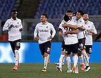 Calcio, Serie A: Roma vs Bologna. Roma, stadio Olimpico, 11 aprile 2016.<br /> Bologna's Luca Rossettini, third from right, celebrates with teammates after scoring during the Italian Serie A football match between Roma and Bologna at Rome's Olympic stadium, 11 April 2016.<br /> UPDATE IMAGES PRESS/Isabella Bonotto