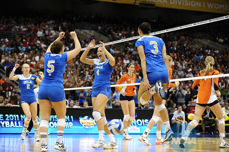 17 DEC 2011:  Sara Sage (04) of UCLA cheers after a point won against Illinois during the Division I Women's Volleyball Championship held at the Alamodome in San Antonio, TX. UCLA defeated Illinois 3-1. Joshua Duplechian/NCAA Photos