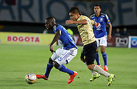 BOGOTA - COLOMBIA - 30-08-2015: Deiver Machado jugador de Millonarios  disputa el balon con Esteban Castaneda de Aguilas Doradas    durante partido  por la fecha 9 de la Liga Aguila II 2015 jugado en el estadio Nemesio Camacho El Campin . / Deiver Machado player of Millonarios fights the ball against Esteban Castaneda of Aguilas Doradas during a match for the ninth date of the Liga Aguila II 2015 played at Nemesio Camacho El Campin stadium in Bogota  city. Photo: VizzorImage / Felipe Caicedo / Staff.