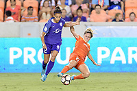 Houston, TX - Saturday June 17, 2017: Camille Levin strips the ball from Kristen Edmonds during a regular season National Women's Soccer League (NWSL) match between the Houston Dash and the Orlando Pride at BBVA Compass Stadium.