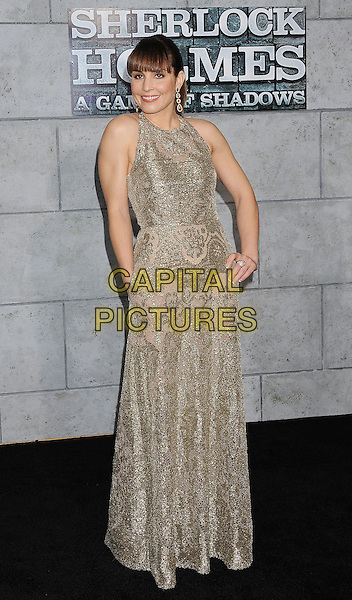 Noomi Rapace.The World Premiere of 'Sherlock Holmes: A Game of Shadows' held at The Village Theatre in Brentwood, California, USA..December 6th, 2011.full length dress silver beads beaded embroidered hand in pocket sleeveless fringe bangs hair on hip.CAP/ROT/TM.©Tony Michaels/Roth Stock/Capital Pictures