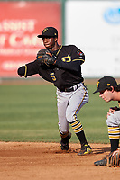 Bristol Pirates shortstop Victor Ngoepe (5) throws to first base during a game against the Elizabethton Twins on July 28, 2018 at Joe O'Brien Field in Elizabethton, Tennessee.  Elizabethton defeated Bristol 5-0.  (Mike Janes/Four Seam Images)