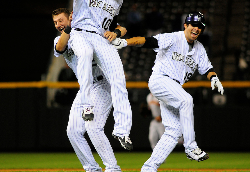 02 September 2008: Colorado Rockies, from left, Troy Tulowitzki, Jeff Baker, and Ryan Spilborghs celebrate a 12th inning walk off RBI single by Spilborghs.  The Rockies defeated the Giants 6-5 at Coors Field in Denver, Colorado. FOR EDITORIAL USE ONLY