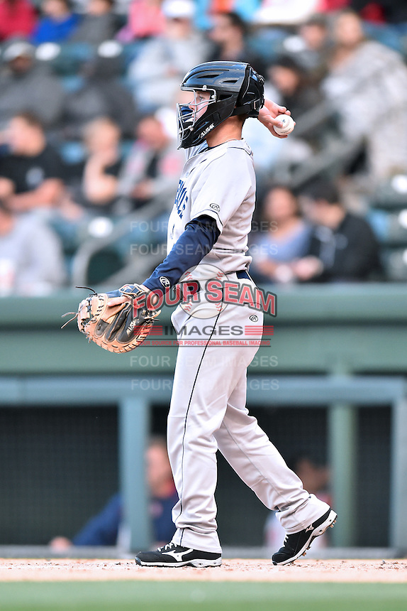 Asheville Tourists infielder Max George (3) warms up the pitcher during a game against the Greenville Drive at Fluor Field on April 7, 2016 in Greenville South Carolina. The Drive defeated the Tourists 4-3. (Tony Farlow/Four Seam Images)
