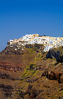 Santorini Greece and the beautiful white buildings on the mountain cliffs of main city of Fira