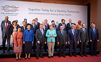 German Chancellor Angela Merkel (C) standing next to Federal Health Minister Hermann Grohe during the family photo of the Meeting of G20 Health Ministers in Berlin, Germany, 19 May 2017. Health Ministers from the G20 states and representatives of international organizations discussed global health topics during the two-day meeting. Photo: Michael Kappeler/dpa