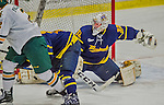 21 February 2015:  Merrimack College Warrior Goaltender Rasmus Tirronen, a Senior from Espoo, Finland, makes a second period kick save against the University of Vermont Catamounts at Gutterson Fieldhouse in Burlington, Vermont. The teams played to a scoreless tie to wrap up the regular home season for the Cats. Mandatory Credit: Ed Wolfstein Photo *** RAW (NEF) Image File Available ***
