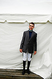 USA, Tennessee, Nashville, Iroquois Steeplechase, a jockey poses in front of the jockey tent