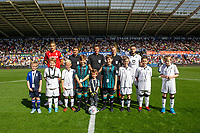 Swansea Mascots with Michael Dawson of Nottingham Forest and Matt Grimes of Swansea City during the Sky Bet Championship match between Swansea City and Nottingham Forest at the Liberty Stadium in Swansea, Wales, UK. Saturday 14 September 2019