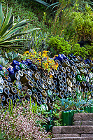 Recycled wine bottles embedded in to hillside by path way in Jim Bishop and Scott Borden garden