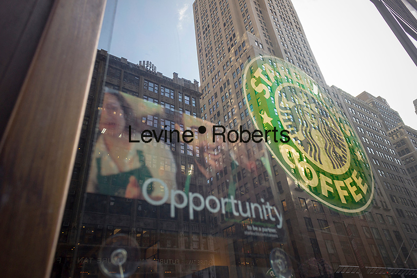A Starbucks cafe in Midtown in New York advertises that the firm is hiring with a sign in the window, seen on Wednesday, March 13, 2013. (© Richard B. Levine)