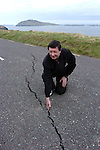 SLEA HEAD ROAD COLLAPSE 9-4-07. A massive cliff collapsed beside the main Slea Head road on the Dingle Penninsula on Monday and large fissures appeared on the road. The road is now closed to traffic and great concern is being expressed about the ramaining roadway.<br /> Picture shows local resident Miceal De Mordha of the Blasket Island Centre examing the fissure after the collapse on Monday.<br /> Picture by Don MacMonagle