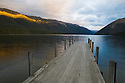 Wooden pier at Lake Rotoiti; sunset, New Zealand, South Island