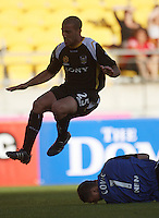 Manny Muscat hurdles Newcastle goalkeeper Ante Covic during the A-League match between Wellington Phoenix and Newcastle Jets at Westpac Stadium, Wellington, New Zealand on Sunday, 4 January 2009. Photo: Dave Lintott / lintottphoto.co.nz