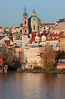 The Vltava river and the Baroque St Nicholas church or Kostel svateho Mikulase, built 1704-1755 by Kilian Dientzenhofer, in the Lesser quarter or Mala Strana, Prague, Czech Republic. The historic centre of Prague was declared a UNESCO World Heritage Site in 1992. Picture by Manuel Cohen