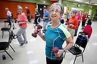 NWA Democrat-Gazette/DAVID GOTTSCHALK Cherie Ressler participates in a Silver Sneakers exercise session Tuesday, April 10, 2018, under the instruction of Cindy Mix at the at the Springdale Senior Activity and Wellness Center. The center will undergo a needs assessment to direct the future of the center.