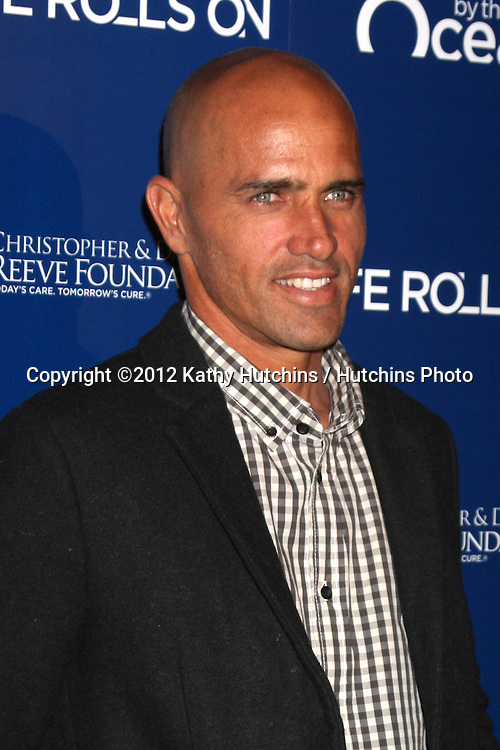 LOS ANGELES - NOV 11:  Kelly Slater arrives at the Life Rolls On Foundation's 9th Annual Night By The Ocean at The Ritz-Carlton on November 11, 2012 in Marina del Rey, CA