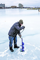 Kyle York, of Sarnia tries a new ice auger on Sarnia Bay to check the ice depth. It is the first time he's been fishing this winter. He said there are other fishers fishing, but they are also staying close to the shoreline until ice thickens.
