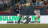 FOXBOROUGH, MA - JULY 27: Dillon Powers #5 passes the ball as Edgar Castillo #8 defends during a game between Orlando City SC and New England Revolution at Gillette Stadium on July 27, 2019 in Foxborough, Massachusetts.