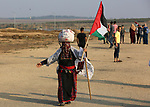 Palestinians take part in a protest to demand the right to return to their homeland at the Israel-Gaza border, in the east of Gaza City on October 16, 2019. Photo by Ashraf Amra