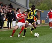 Burton Albion v Barnsley 16.4.16 .Sky Bet League 1 ....... Burtons Lucas Atkins holds off Barnsleys George Williams