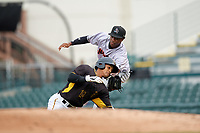 Jupiter Hammerheads right fielder Anfernee Seymour (26) tags Adrian Valerio (14) out after a run down during a game against the Bradenton Marauders on May 25, 2018 at LECOM Park in Bradenton, Florida.  Jupiter defeated Bradenton 3-2.  (Mike Janes/Four Seam Images)