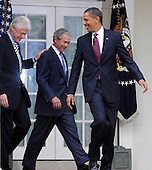 U.S. President Barack Obama (R) looks back at former Presidents Bill Clinton (L) and George W. Bush as they depart the Oval Office after meeting with Obama in the  aftermath of the devastating earthquake in Haiti, at the White House in Washington, DC, USA, 16 January 2010.  Obama discussed enlisting the help of the American people to help in the recovery and rebuilding of Haiti.  .Credit: Mike Theiler / Pool via CNP