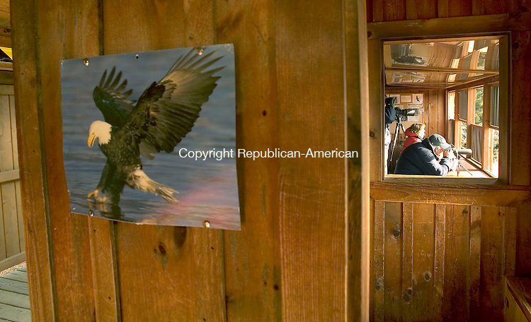 SOUTHBURY, CT- 13 JANUARY 2008-011308JS06--A painting of a bald eagle hangs on the wall while visitors look for bald eagles Sunday at the Shepaug Eagle Observation Area at the Shepaug Dam in Southbury. <br /> Jim Shannon / Republican-American