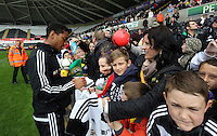 Wednesday, 23 April 2014<br /> Pictured: Jonathan de Guzman signing autographs for supporters.<br /> Re: Swansea City FC are holding an open training session for their supporters at the Liberty Stadium, south Wales,